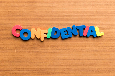 arcane: confidential colorful word on the wooden background Stock Photo
