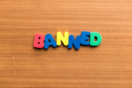 banned: banned colorful word on the wooden background Stock Photo