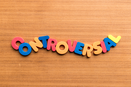 controversial colorful word on the wooden background