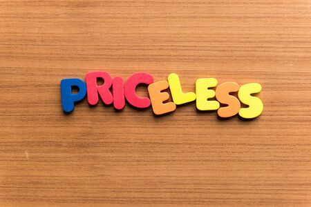 priceless: priceless colorful word on the wooden background