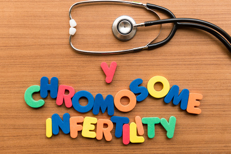 chromosome: Y chromosome infertility colorful word with stethoscope on wooden background Foto de archivo