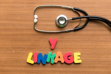 linkage: y linkage colorful word with stethoscope on wooden background