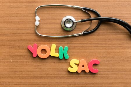 sac: yolk sac colorful word with stethoscope on wooden background Stock Photo