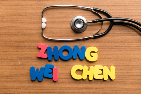 wei: zhong wei chen colorful word with stethoscope on wooden background