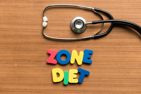 zone diet colorful word with stethoscope on wooden background