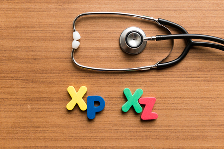 xp: xp xz colorful word with stethoscope on wooden background