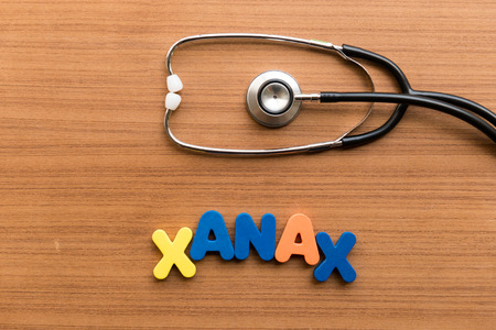 xanax colorful word with stethoscope on wooden background Standard-Bild