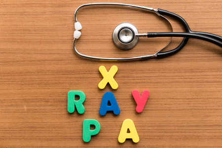 pa: x ray pa colorful word with stethoscope on wooden background
