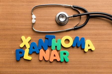 planar: xanthoma planar colorful word with stethoscope on wooden background