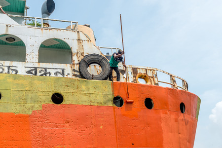 DHAKA, BANGLADESH - August 13: Local workers are working to repair ships in dockyard on August, 13, 2016 in Dhaka, Bangladesh Editorial