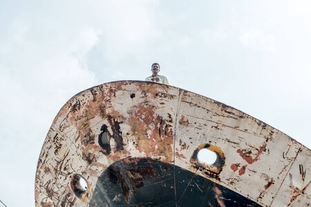 restore: DHAKA, BANGLADESH - August 13: Local workers are working to repair ships in dockyard on August, 13, 2016 in Dhaka, Bangladesh Editorial