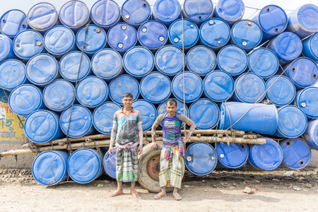 dhaka: DHAKA, BANGLADESH - August 12: Local workers are working to repair ships in dockyard on August, 12, 2016 in Dhaka, Bangladesh