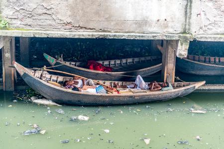 dhaka: Dhaka, Bangladesh - August 13, 2016: people lifestyle in Sadar Ghat on August 13, 2016 in Dhaka,Bangladesh.