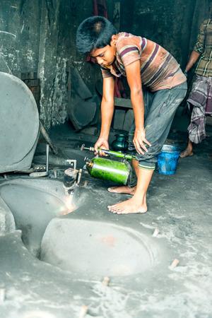dhaka: DHAKA, BANGLADESH - August 13: Local workers are working to repair ships in dockyard on August, 13, 2016 in Dhaka, Bangladesh Editorial