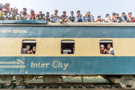Dhaka, Bangladesh - January 15, 2017: Unindentified muslims are returning home from  bishwa ijtema at Tongi, dhaka, Bangladesh.