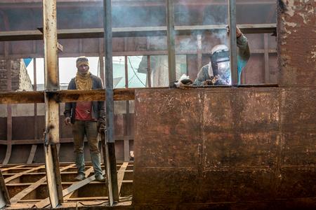 DHAKA, BANGLADESH - December 13: Local workers are working to repair ships in dockyard on December, 13, 2016 in Dhaka, Bangladesh