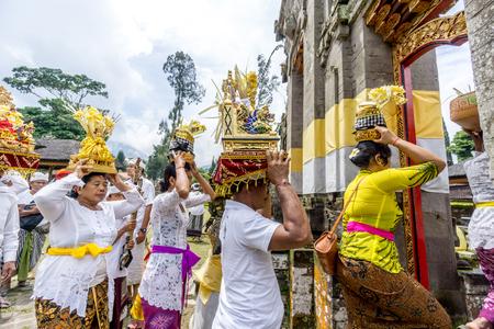 Bali, Indonesia - December 23, 2016 : Hindu women praying at balinese temple in Bali, Indonesia