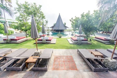 Bali, Indonesia - December 24, 2016:   Hotel outdoor beds of luxury hotel at bali, indonesia Editorial