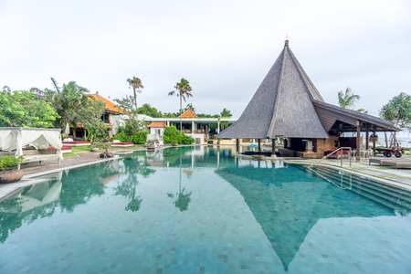 Bali, Indonesia - December 24, 2016:   Swimming pool of luxury hotel at bali, indonesia