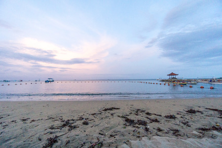 Sunset over sand at bali, indonesia
