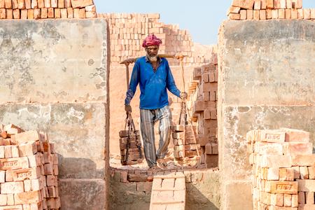Dhaka, Bangladesh - January 21, 2017: Workers are working in Brick Field at Amin bazar, dhaka, Bangladesh.
