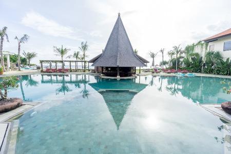 Bali, Indonesia - December 25, 2016:   Swimming pool of luxury hotel at bali, indonesia