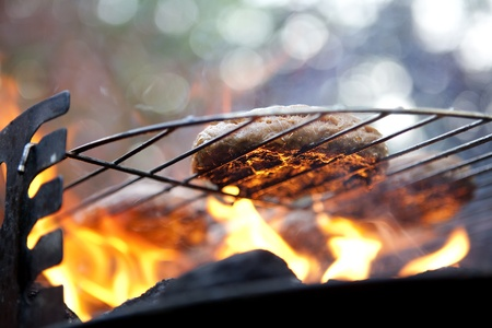 barbecue fire: Burgers on a Barbecue