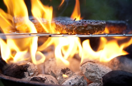 garden barbecue: Barbecue cooking burgers