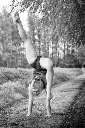 b w: gymnastic pose in nature