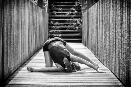 b w: flexible toe doing gymnastics