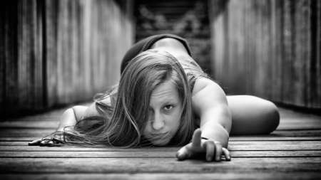 b w: girl doing gymnastics on the ground