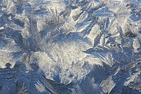 ice crystals: winter pattern of ice crystals on glass.