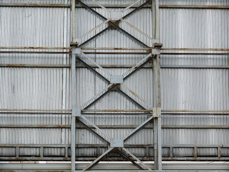 roof profile: a large fence made of metal frame and sheet.