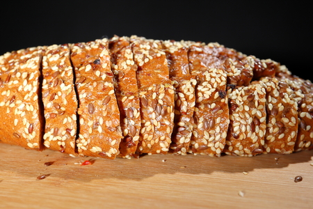 freshly baked multigrain bread on rustic background, top view. Stock Photo