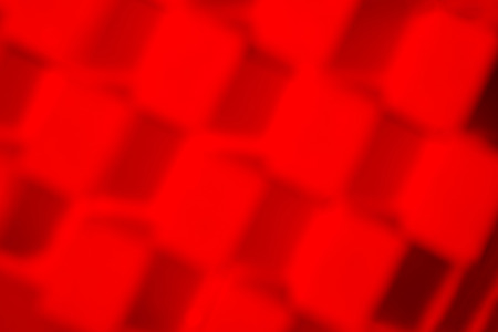 Composition of sugar cubes with red light. Blurred background.