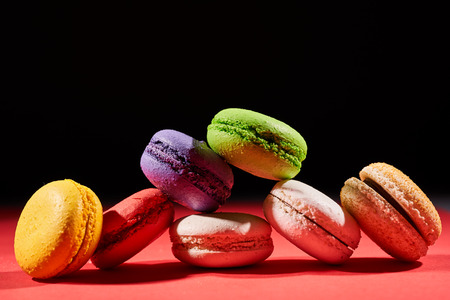 Cake macaron or macaroon on black background from, colorful almond cookies. Stock Photo