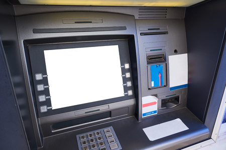 Street ATM teller machine with current operation. Blank screen for mockup. Stock Photo
