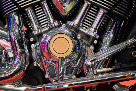 The powerful engine of a modern motorcycle closeup. The layout of the motor. Фото со стока