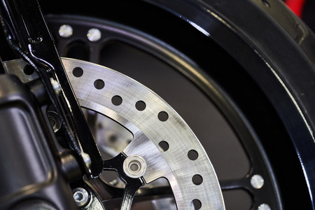 The front wheel of a modern motorcycle.