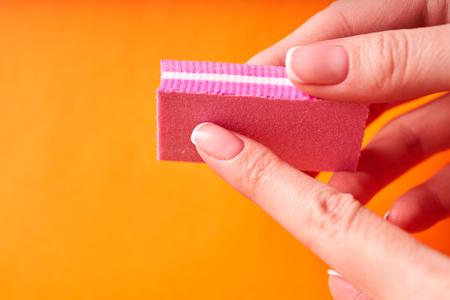 Finish grinding women nail art sponge manicure.