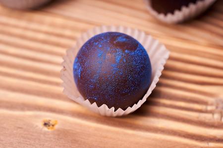 Chocolates with blue algae on wooden background Stok Fotoğraf