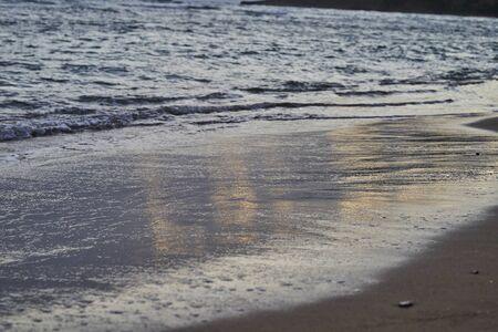 Sandy coast with sea waves at sunrise Zdjęcie Seryjne