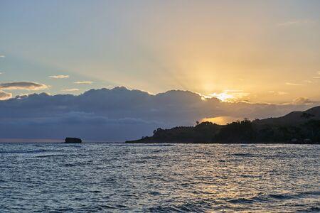 Sunrise over a tropical island. Beautiful seascape