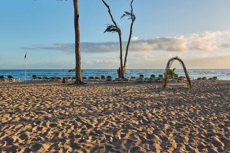 Tropical sandy beach at sunrise. Beach infrastructure. Zdjęcie Seryjne - 125340231