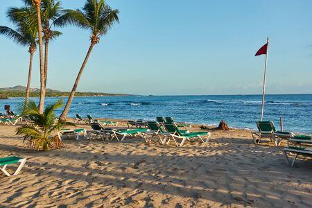 Tropical sandy beach at sunrise. Beach infrastructure. Zdjęcie Seryjne