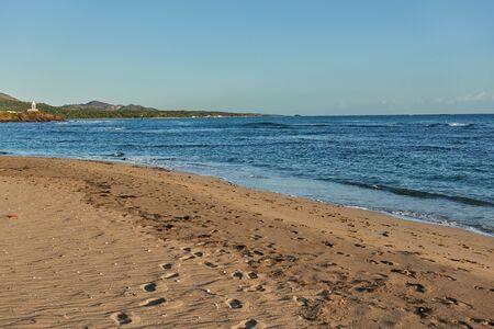 Sunrise over a tropical island with a sandy beach