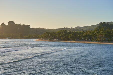 Ocean coast in the tropics with a sandy beach.