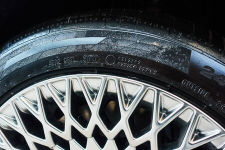 Wheel of a modern car with part of rim and tyre. Stok Fotoğraf