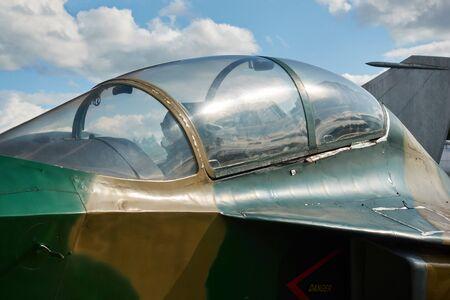 Jet fighter at the airport. The pilot's cockpit closeup. 免版税图像 - 130747622