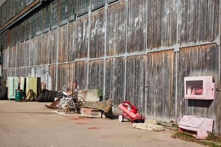 Old hangar at the airport with items for aviation maintenance.